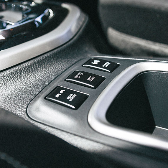 Navara switches near cup holders